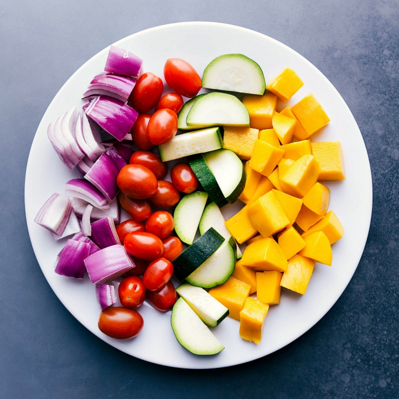 Overhead image of the fresh fruit and veggies on a plate before being grilled