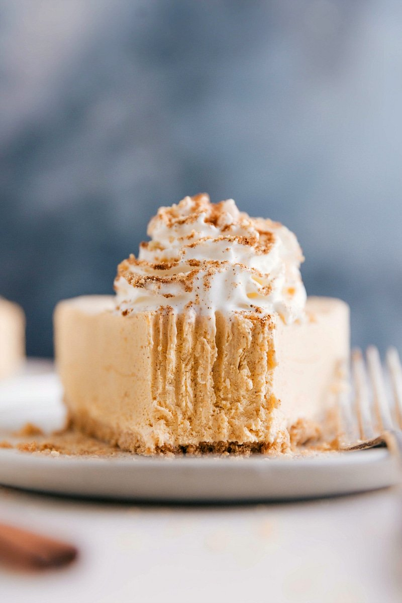 Image of No-Bake Pumpkin Cheesecake slice with a bite out of it