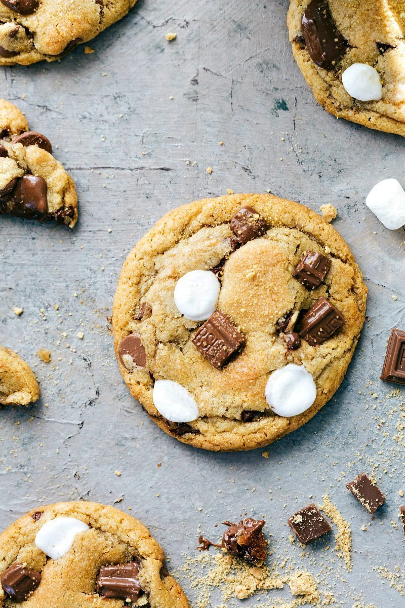 The BEST EVER S'mores Cookies with THREE kinds of chocolate, graham cracker crumbs, and mini marshmallows! via chelseasmessyapron.com