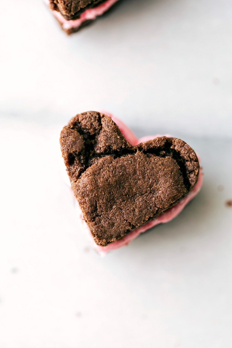 Valentine's Oreos -- regular sandwich cookies OR heart-shaped sandwich cookies. The cookie base has only 4 ingredients and the filling tastes just like a real Oreo! via chelseasmessyapron.com
