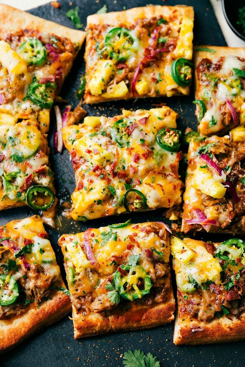 BBQ Pulled Pork Pizza is so quick and easy to make and perfect for busy nights! A container of pre-made BBQ pork makes this pizza especially easy! chelseasmessyapron.com