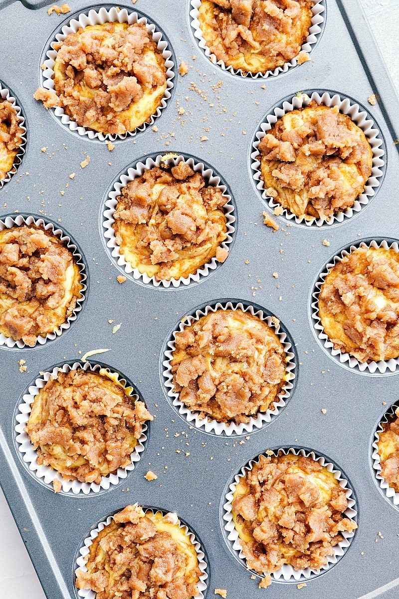Cinnamon roll cupcakes in a cupcake cooking pan.