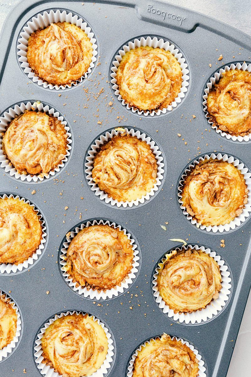 Cinnamon roll cupcakes in a cupcake cooking sheet.