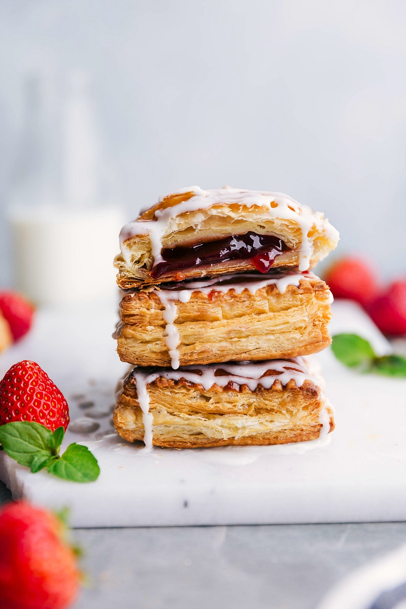 Image of Toaster Strudels stacked on top of each other, with fresh strawberries on the side.