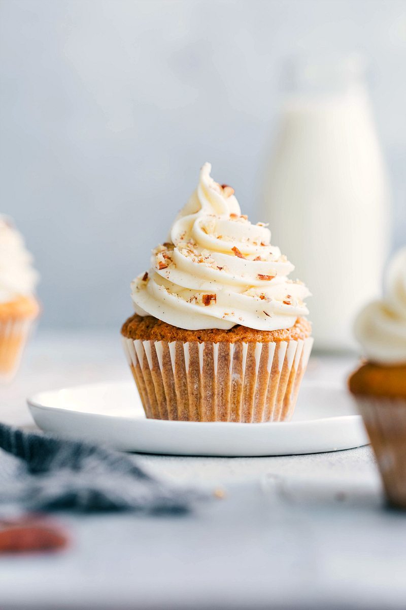 Flavorful, soft, and moist carrot cake cupcakes with the best cream cheese frosting! chelseasmessyapron.com #carrotcakecupcakes #carrot #cake #cupcakes #dessert #easter #creamcheese #frosting #easy #dessert