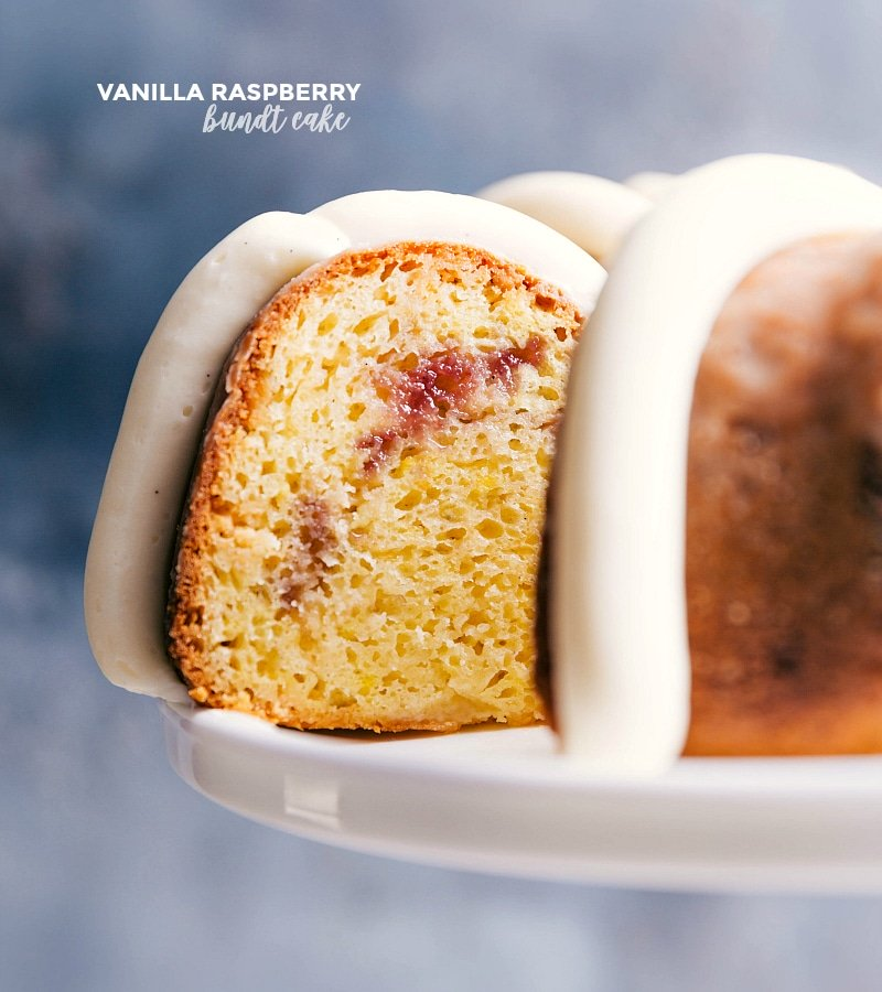 Image of the Vanilla Raspberry Bundt Cake with a slice being taken out.