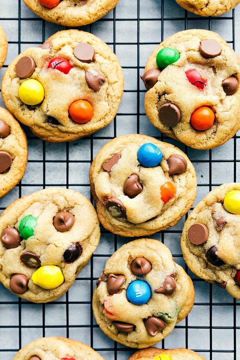 Loaded caramel stuffed cookies with big chocolate chips, gooey caramel center, and big M&Ms. Recipe via chelseasmessyapron.com