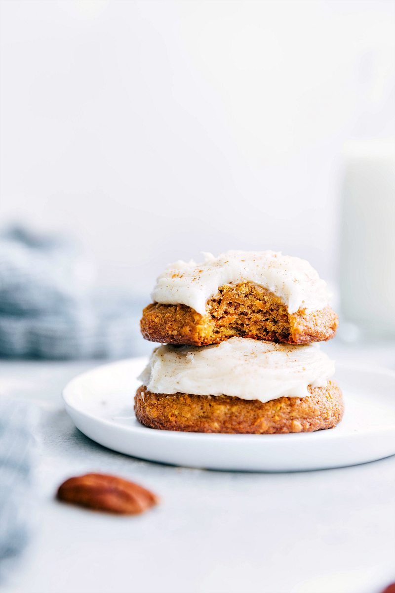 The ultimate BEST EVER bakery-style carrot cake cookies with a rich cream cheese frosting! via chelseasmessyapron.com | #carrot #cake #cookies #easy #quick #dessert #carrotcake #soft #baked #bakery #style #cream #cheese #frosting #desserts #dessert #Easter