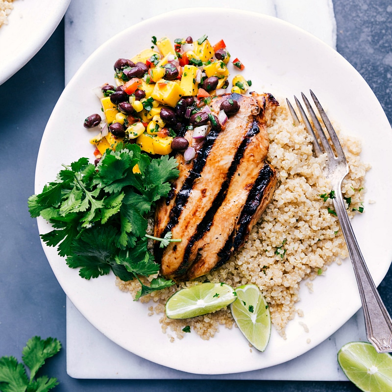 Overhead image of the quinoa chicken on a plate with a fork in the side ready to be eaten.