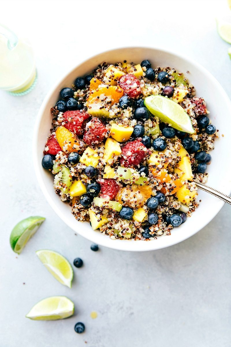 FRUIT QUINOA SALAD! A tri-colored quinoa salad packed with tropical fruits and dressed in a tangy citrus dressing. This salad is vibrant, healthy, and delicious! I Easy recipe from chelseasmessyapron.com