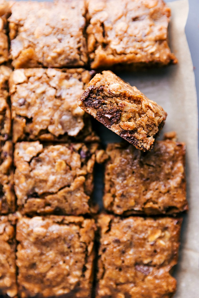 A close-up view of the soft-baked oatmeal Breakfast bars with a bar tilted up to show the inside.