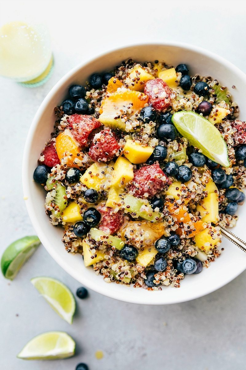 FRUIT QUINOA SALAD! A tri-colored quinoa salad packed with tropical fruits and dressed in a tangy citrus dressing. This salad is vibrant, healthy, and delicious! via chelseasmessyapron.com