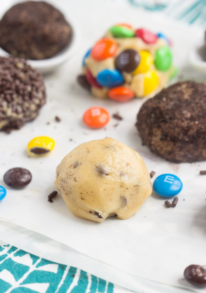 A no-bake cookie ball that is egg free with three ideas of what to roll the cookie dough in - crushed Oreos, M&M candies, and sprinkles.