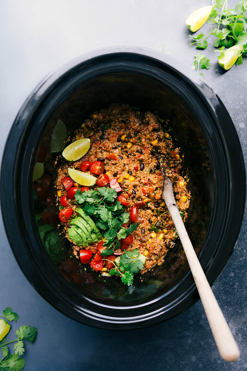 Overhead image of Tex-Mex Quinoa in the crockpot with a spoon in the pan.