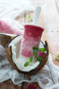 Coconut Raspberry Lime Popsicles. AMAZING flavor and healthy! #popsicle #raspberry #lime #coconut