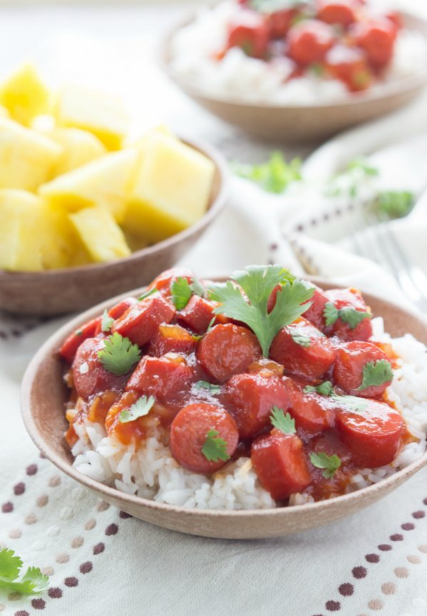 A simple, under 30 minute meal with hot dogs in a homemade sweet BBQ sauce served over white rice.
