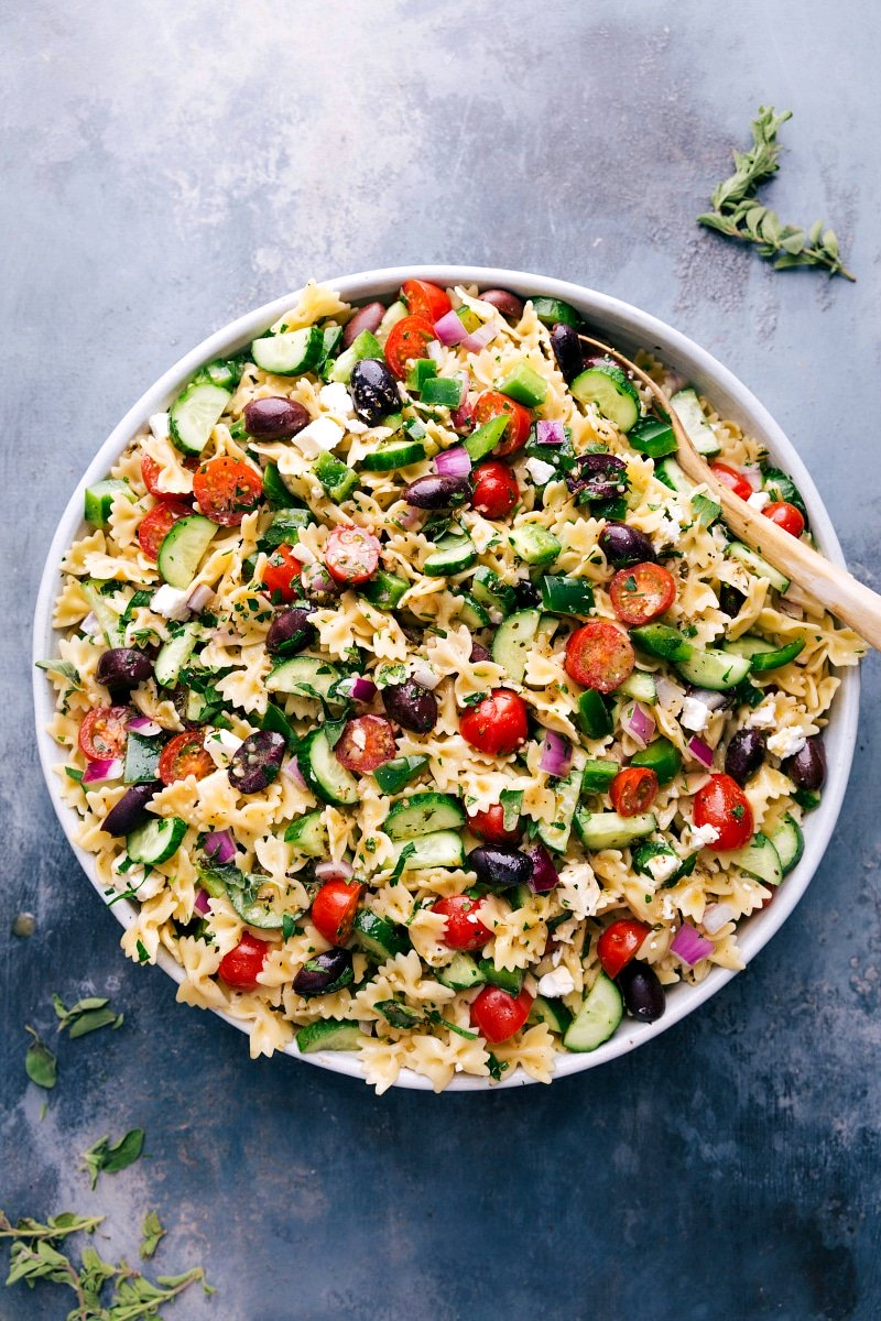 Overhead image of Greek Pasta Salad, ready to be eaten.