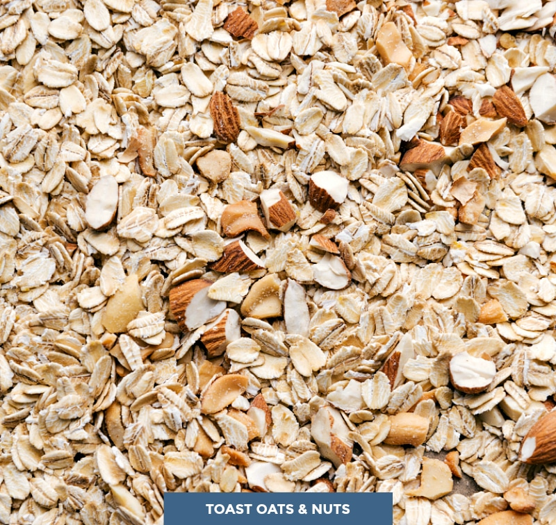 Close-up image of the oats and nuts, ready to toast in the oven.