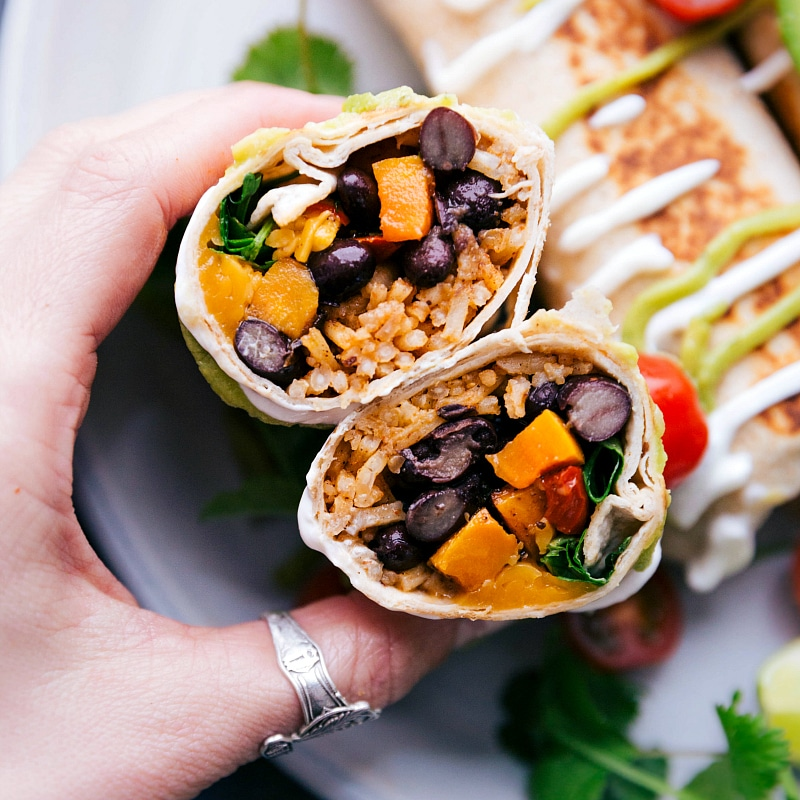 Close-up photo of Healthy Burritos, cut in half to display the filling.