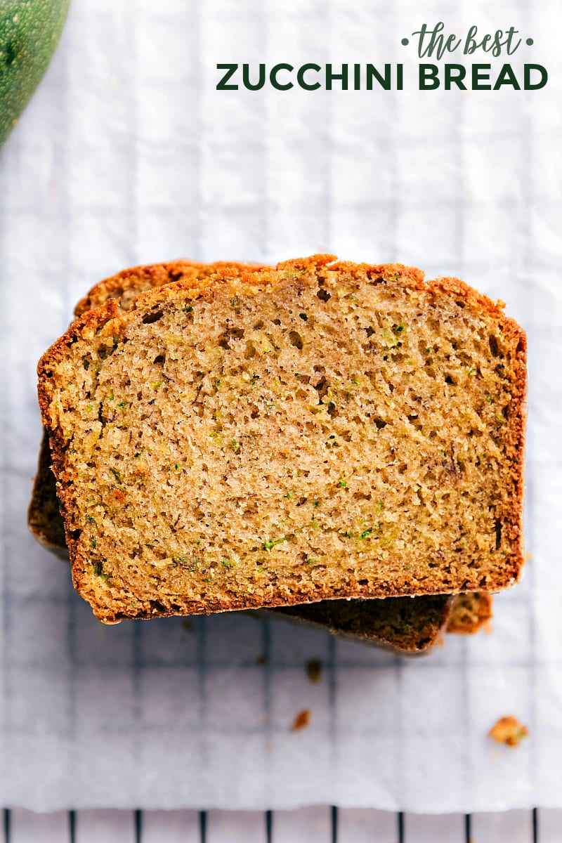 Up close photo of zucchini bread. Three slices of this easy zucchini bread are stacked on top of each other.
