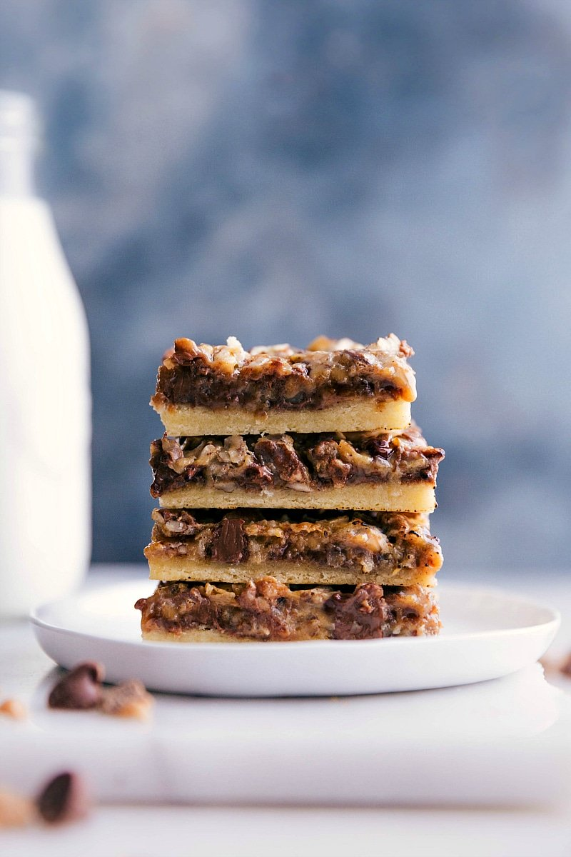 Image of the 7-Layer Pumpkin Bars stacked on top of each other ready to be eaten.