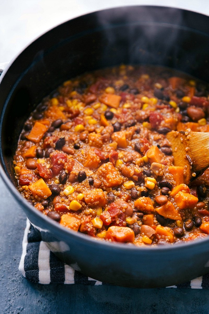 Image of the quinoa chili in a pot with steam coming up and ready to be served