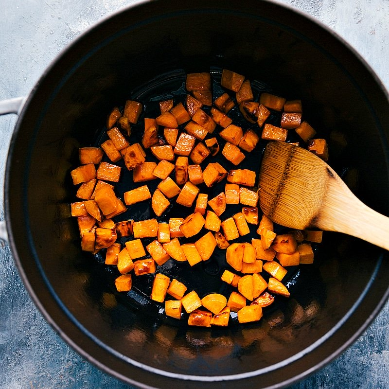 Process shot-- image of the sweet potatoes in a pot being cooked for this sweet potato quinoa chili