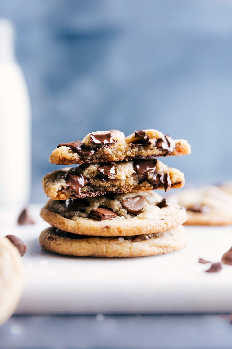 Images of Small Batch Chocolate Chip Cookies stacked on top of each other with one of them broken open showing the inside.
