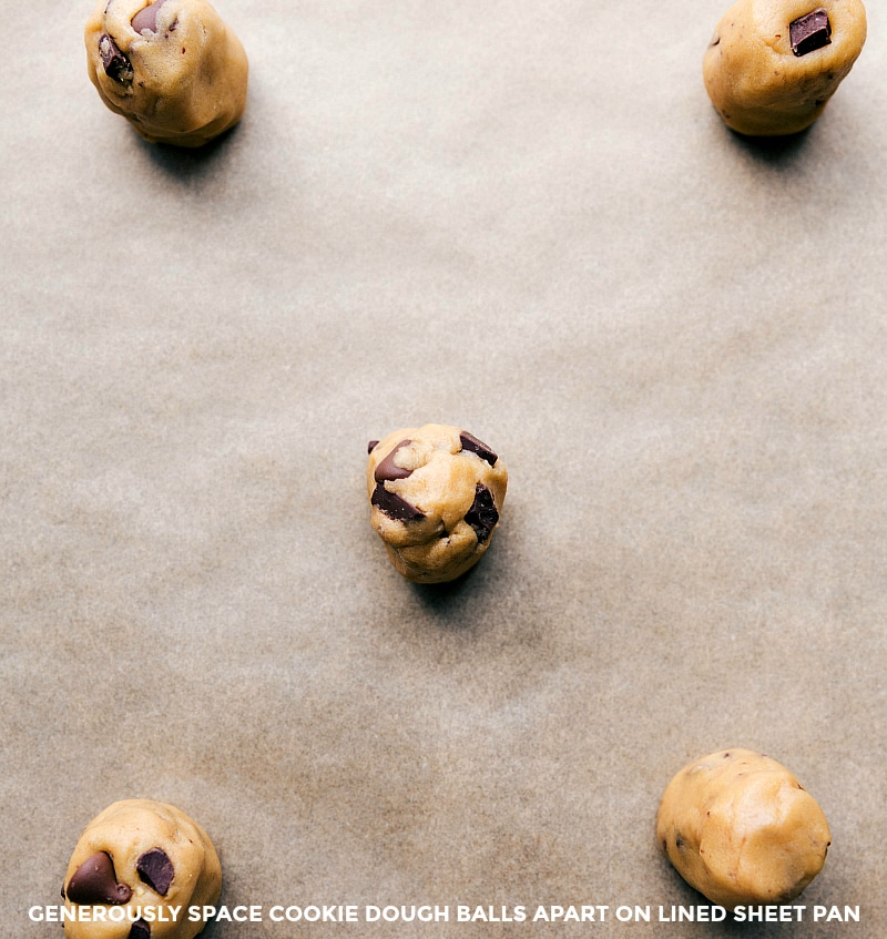 Overhead image of the dough balls on a sheet pan lined with parchment paper.
