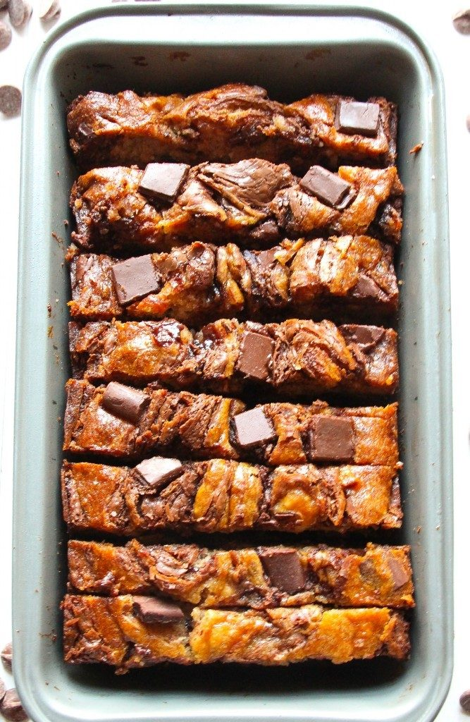 The BEST Nutella-Swirled Banana Bread with Macadamia Nuts. Gooey, chocolatey, and delicious!