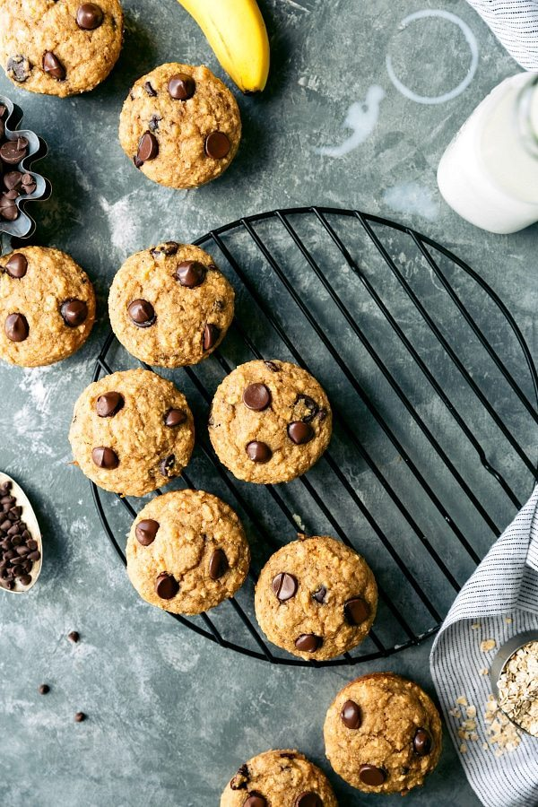 Greek yogurt banana oat muffins made with no flour, no oil, and no butter. PLUS there is little sugar required for these tasty muffins! via chelseasmessyapron.com