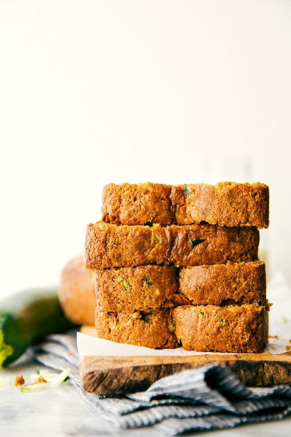 Up close shot of the BEST healthier Greek yogurt zucchini bread. Healthy zucchini bread slices are stacked on top of each other.