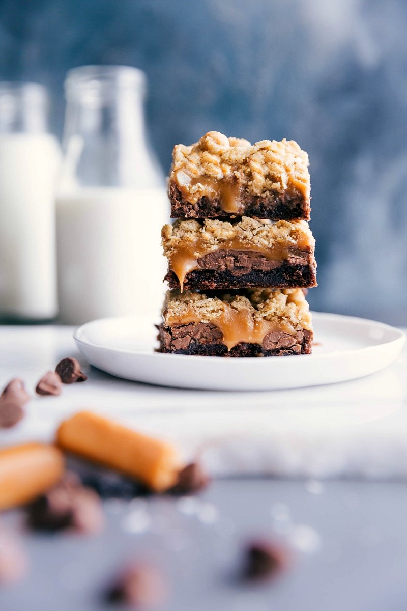 Image of the Cookie Brownie Bars stacked on top of each other.