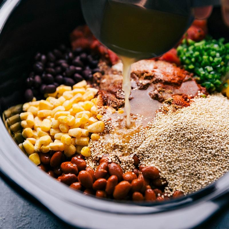 Adding vegetable stock to Crockpot Quinoa.