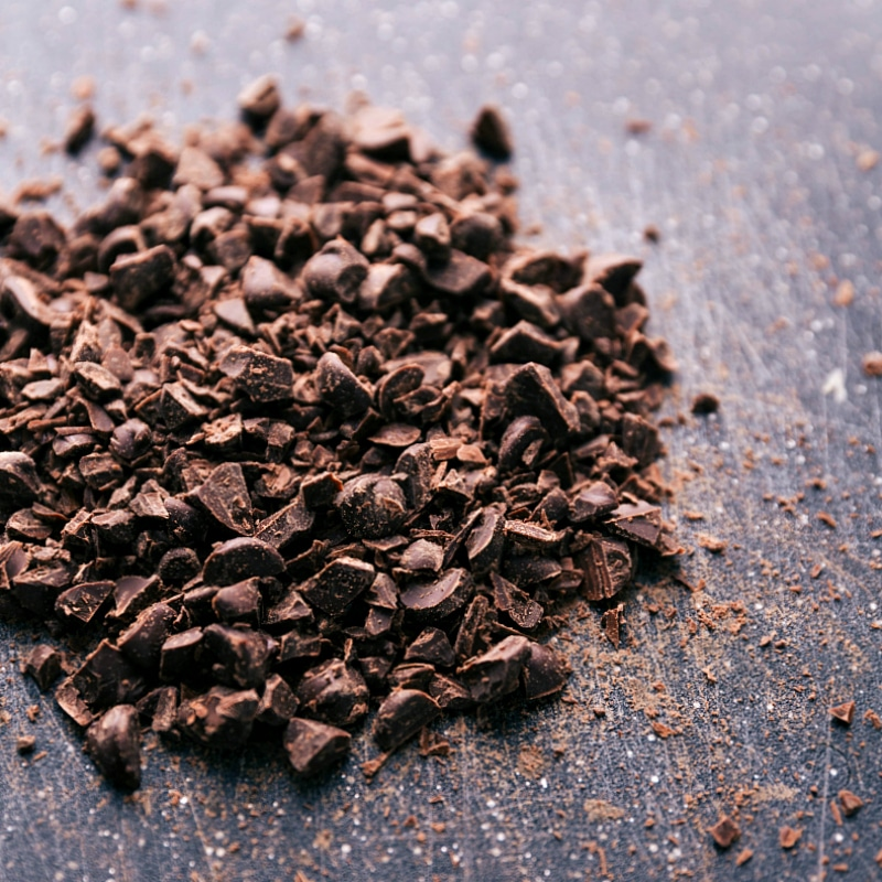Image of chopped chocolate on a cutting board.