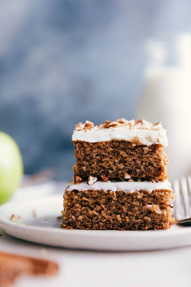 Image of two slices of Applesauce Cake stacked on top of each other ready to be eaten.