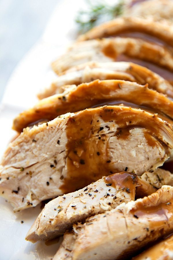 The most tender and deliciously seasoned crockpot turkey breast. Perfect for smaller holiday get togethers or to have turkey ready for lunches and salads during the week. | chelseasmessyapron.com