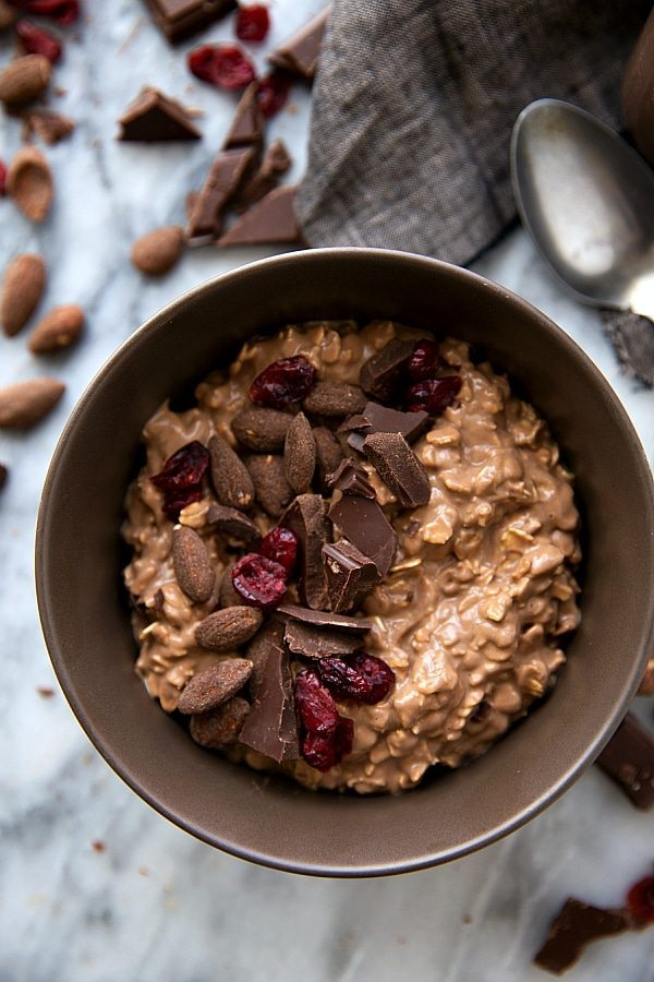 Overnight oatmeal flavored to taste like chocolate-covered almonds. Add in some dried cranberries and enjoy a delicious, quick, & easy seasonal breakfast!