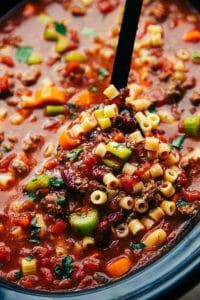 A delicious and hearty slow cooker pasta, vegetable, and ground beef soup copycatting the famous Olive Garden Pasta fagioli