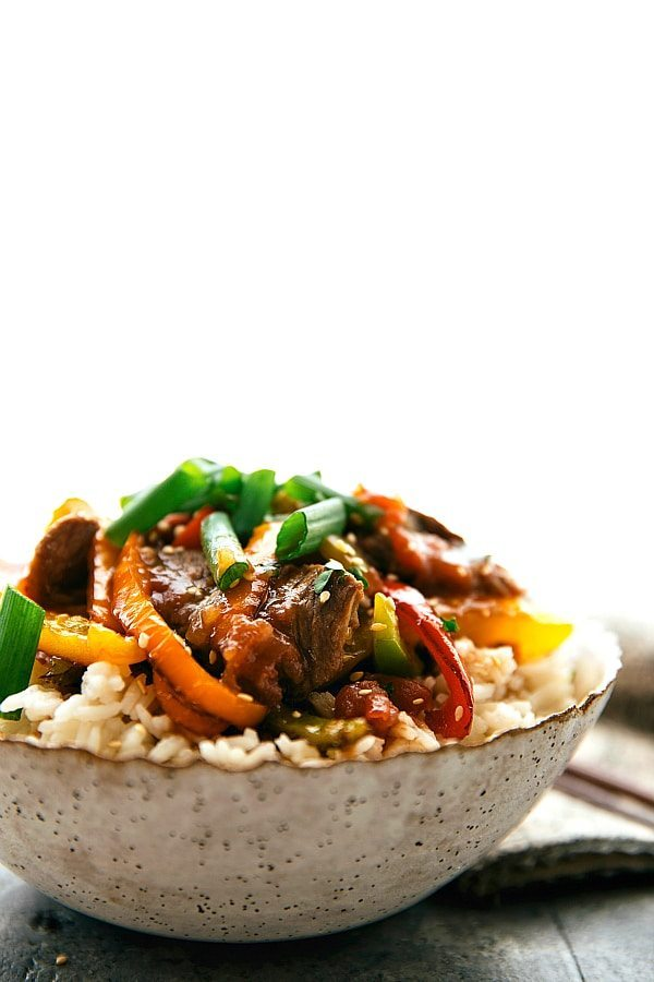 Delicious and simple pepper steak made in the slow cooker. The steak and peppers become super tender after slow cooking all day!