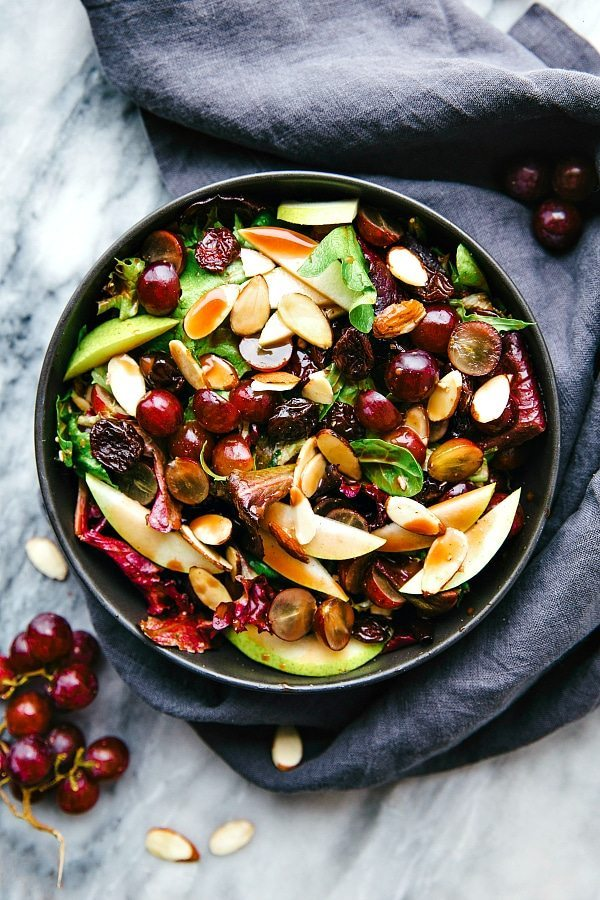 The easiest blender cherry balsamic dressing on a simple Zupas copycat salad! Grapes, pear, almonds, and dried cherries on a bed of mixed greens