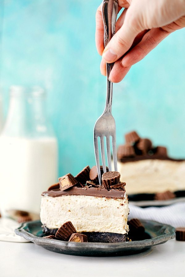 "A delicious and extremely simple (15 minutes prep!) no bake peanut butter cup cheesecake. Oreo crust, creamy peanut butter filling, and a ""magic shell"" chocolate topping."