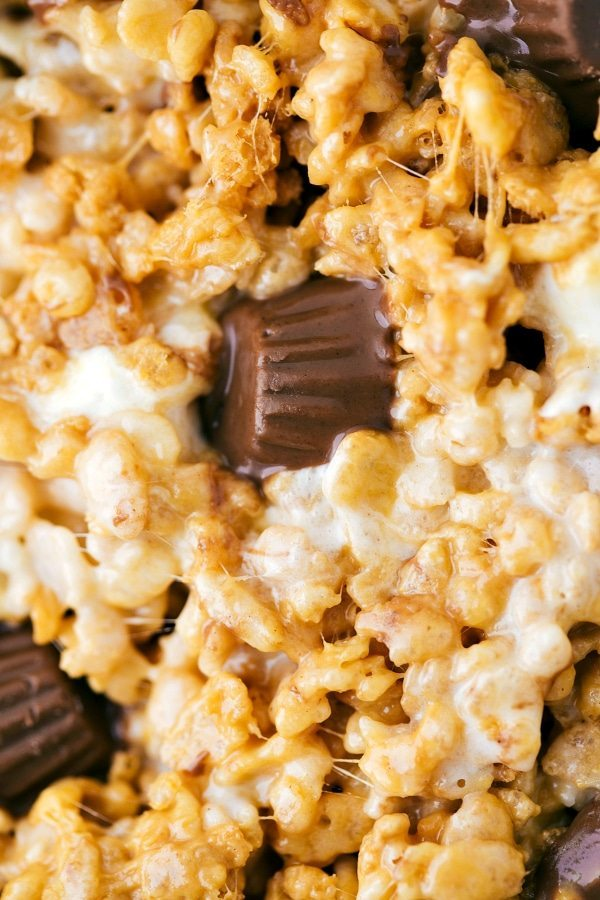Extra gooey & delicious peanut butter cup flavored rice krispies treats with miniature reese's cups and a chocolate topping.