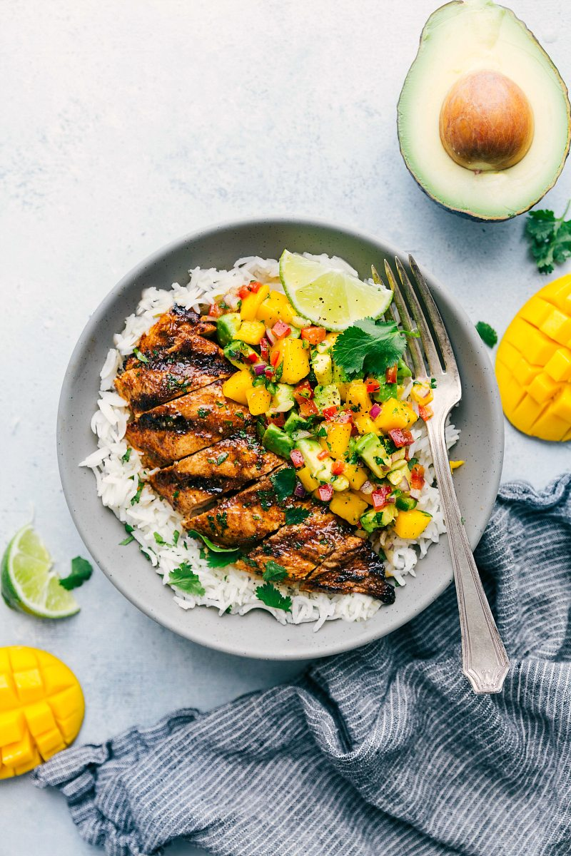 Bowl of cilantro lime chicken with mango avocado salsa served over cilantro lime rice
