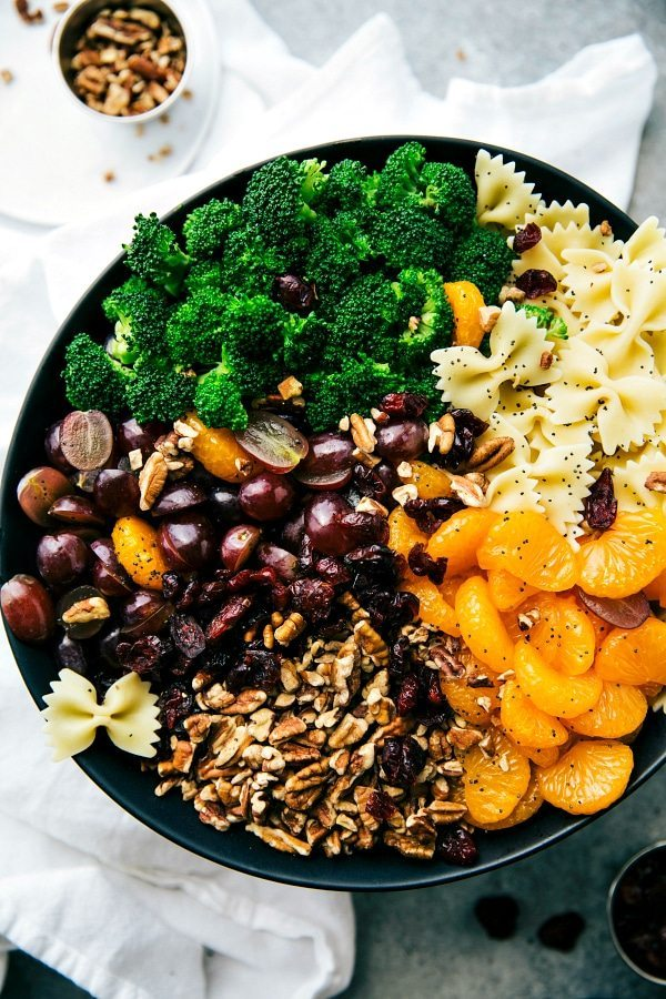 BROCCOLI PASTA SALAD. Broccoli, pasta, grapes, pecans, mandarin oranges, and dried cranberries. Quick to make, 5-ingredient dressing, and sure to be a hit at your next summer party! Via chelseasmessyapron.com