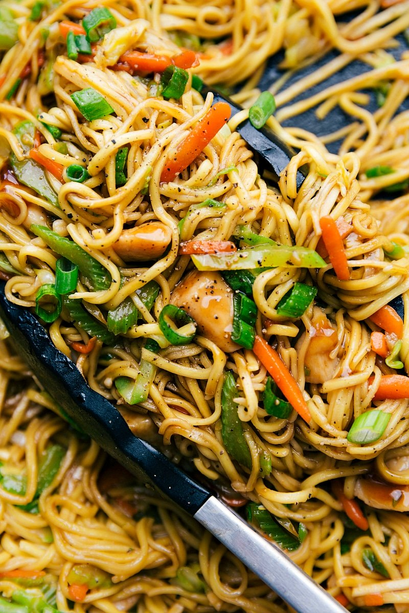 Image of the ready to eat chicken chow Mein with tongs in it