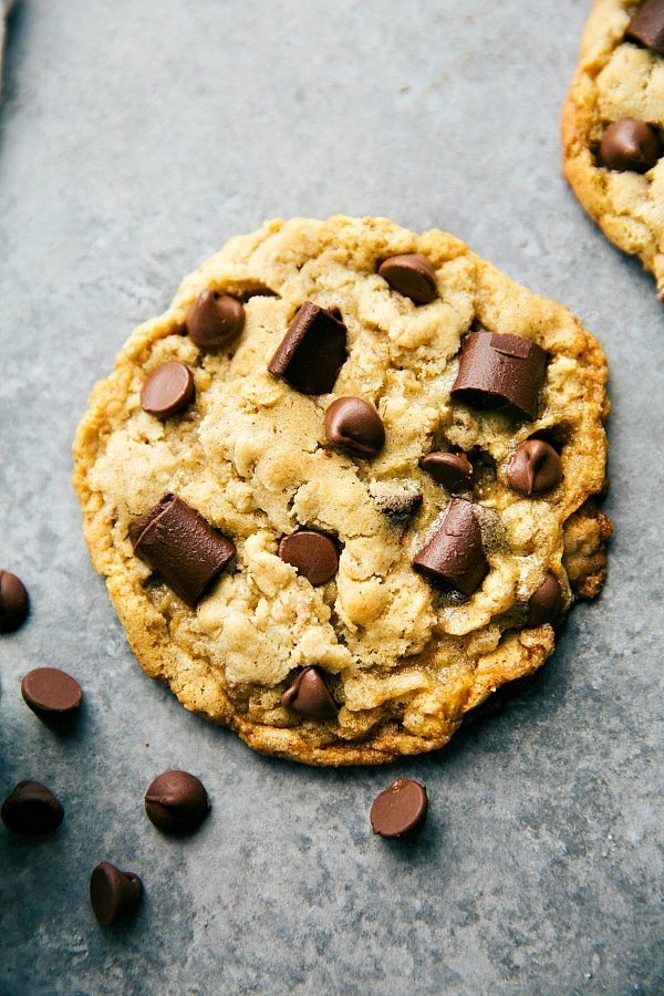 You won't be tempted to eat an entire batch of cookies with this recipe. These oatmeal chocolate chip cookies are gooey, stuffed with oats and chocolate, and perfect to satisfy your cravings | chelseasmessyapron.com