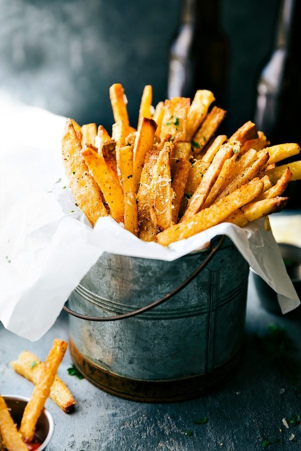 The secrets to the very best EXTRA CRISPY oven baked Parmesan fries! Via chelseasmessyapron.com