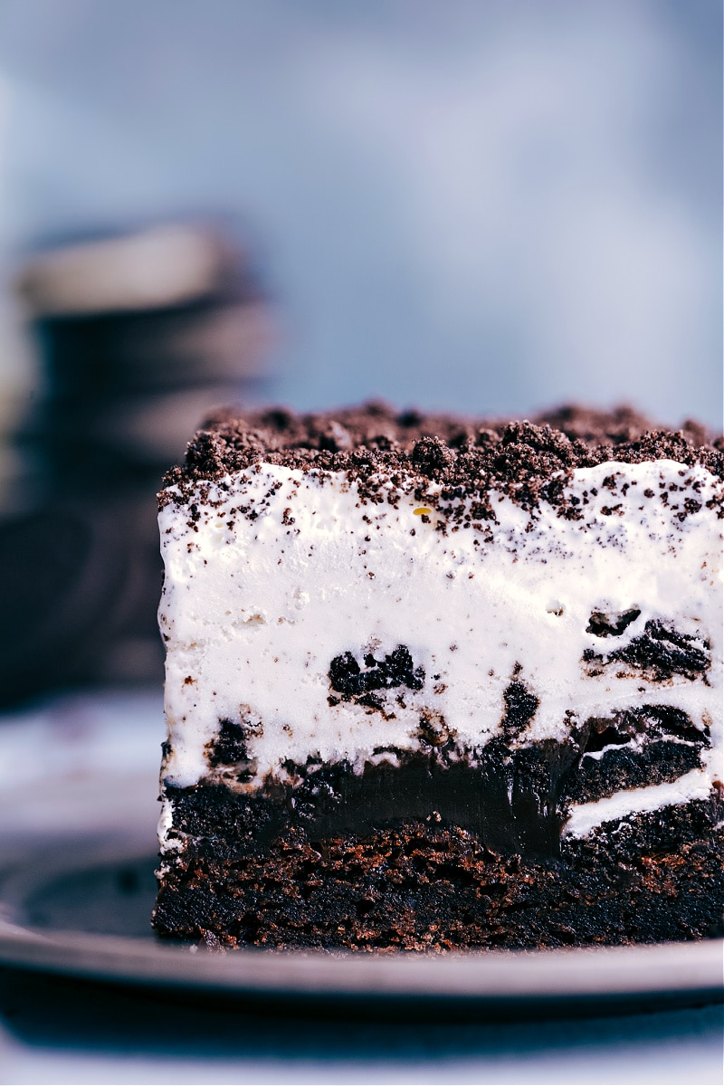Up-close image of a slice of the Brownie Oreo Ice Cream Cake, ready to be eaten.