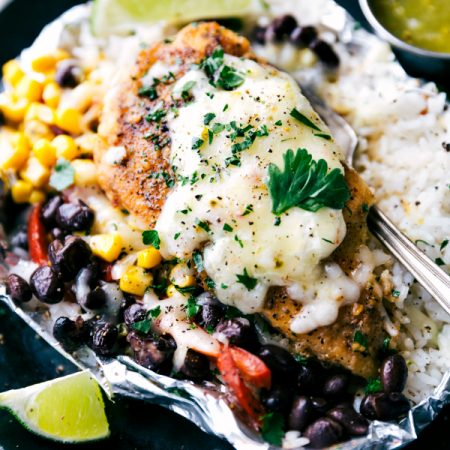 Creamy salsa verde chicken with rice and veggies all cooked at once in a foil packet! No need to pre-cook the rice or chicken